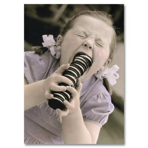 Birthday - Little Girl Eating Oreo Cookies
