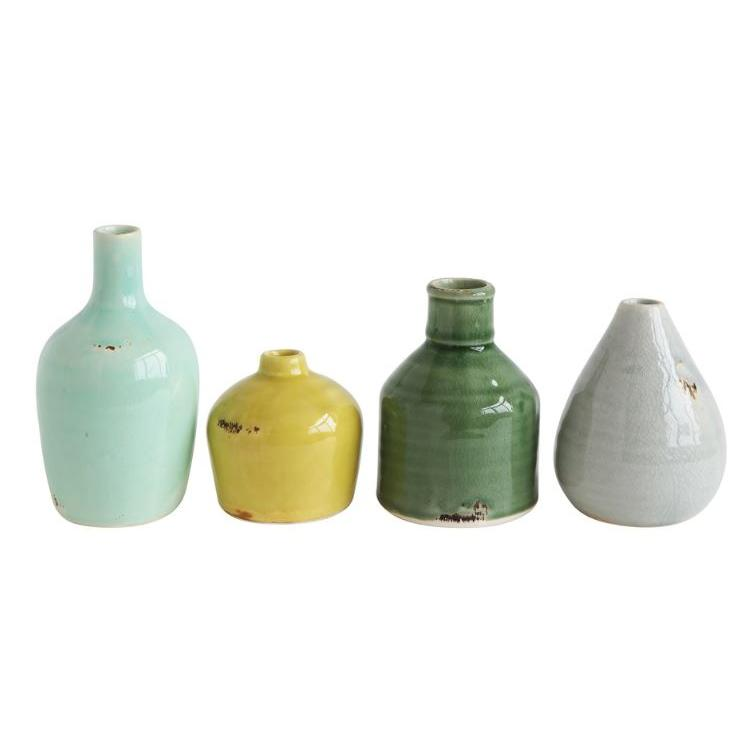 Vase Terracotta Green, Aqua, Yellow and White 4 Styles Sold Each $4.99 $9.99 $9.99 $11.99
